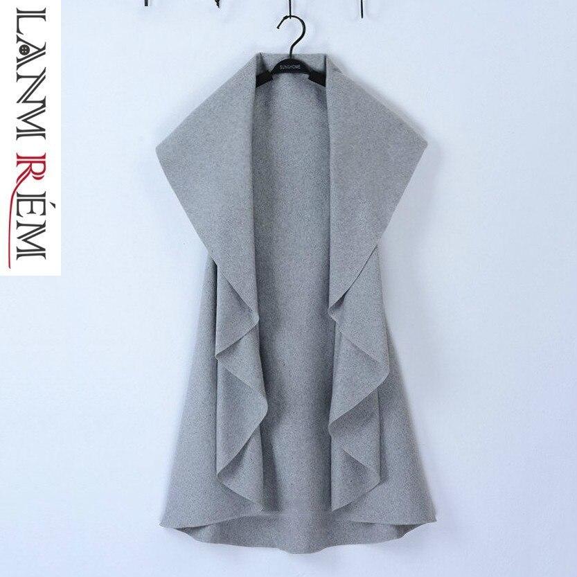 5453a5e7ba49 LANMREM 2018 ropa de otoño nuevo patrón coreano Color sólido onda abierta  corte lana capa Mujer ...