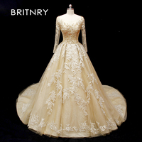 BRITNRY 2019 Luxury Sexy Champagne Gold Wedding Dresses Lace Appliques Beading Tulle Ball Gown Bride Dress Vestido De Noiva