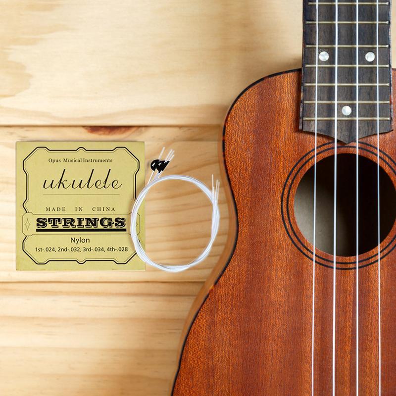 new design 4pcs set universal nylon ukulele strings hawaiian guitar small four string with. Black Bedroom Furniture Sets. Home Design Ideas