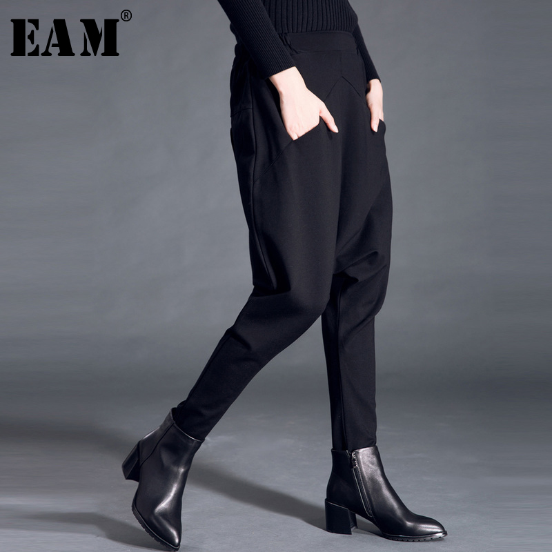 [EAM] 2019 New Autumn Winter High Elastic Waist Black Pocket Split Joint Leisure Loose Harem Pants Women Trousers Fashion JS499