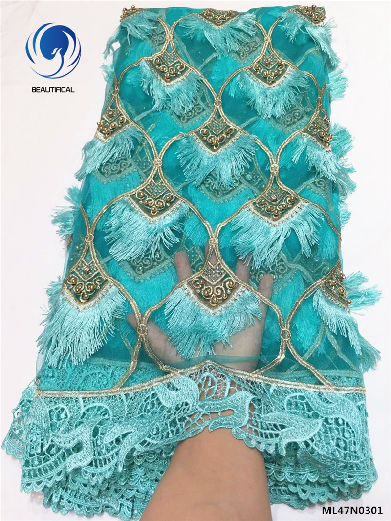 Beautifical african net lace 2019 new design laces dress with beads green tulle laces with tassel for wedding 5yards/lot ML47N03Beautifical african net lace 2019 new design laces dress with beads green tulle laces with tassel for wedding 5yards/lot ML47N03