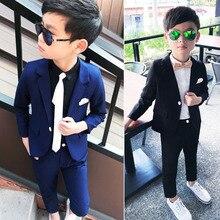 acb51507e Nuevo traje de niño traje para un niño chaqueta azul pantalón 2 piezas de  flores de la boda Vestido de niño de buena calidad de .