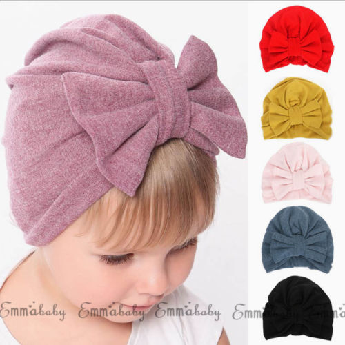 купить Cute Newborn Toddler Kids Baby Boys Girl BIG Bowknot Turban Skull Caps Cotton Beanie Hats Toddler Girls Elastic Winter Warm Cap по цене 53.04 рублей