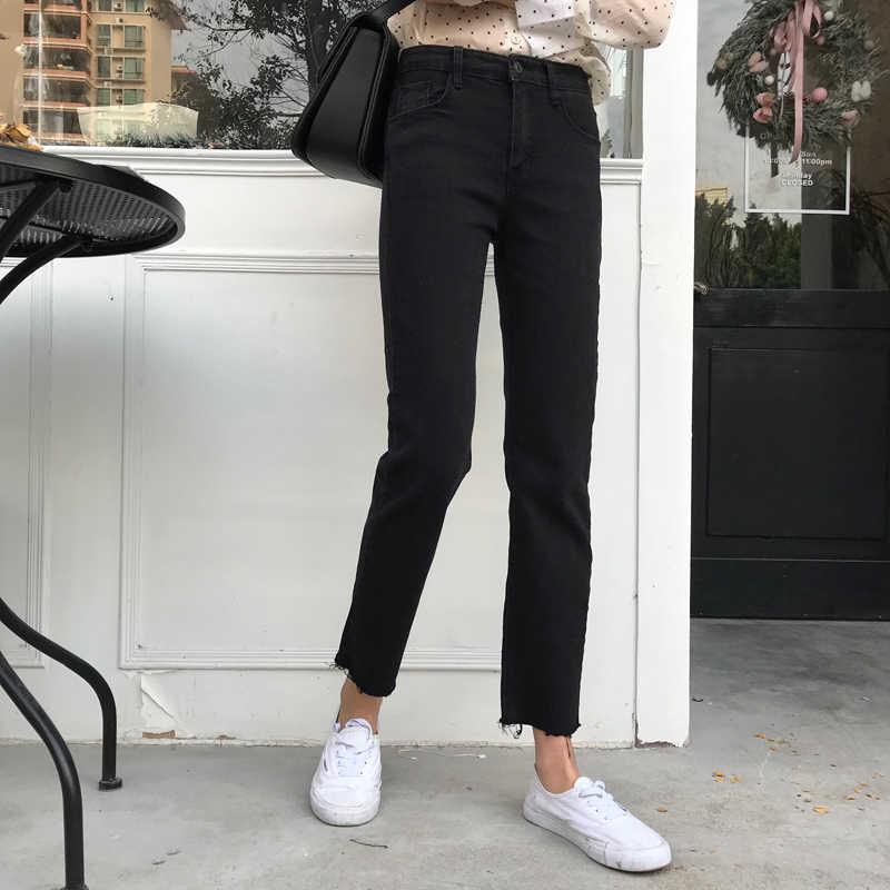 Pantalones de mezclilla elásticos de algodón de alta calidad para mujeres deshilachados dobladillo negro corte recortado