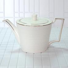 цена на Porcelain teapot green tea puer tea high quality bone china handmade teapot puer tea Exquisite strip pattern 650ml