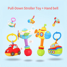 2Pcs Cartoon Pull Down Stroller Toy + Hand bell Baby Rattle Toys Car Seat Crib Bed Pram Plush Hanging Rattle Rocket gifts toys(China)