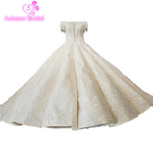AOLANES Tassels Lace Wedding Dress Beaded Crystals V Neck Wedding Gown Champange Wedding Dress Wave Skirt Long Tail Bridal Dress(China)