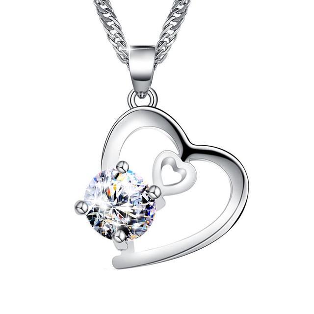 1ec012638ee5 Nuevo colgante de moda collar de plata de las mujeres de Zircon de corazón  de diamantes