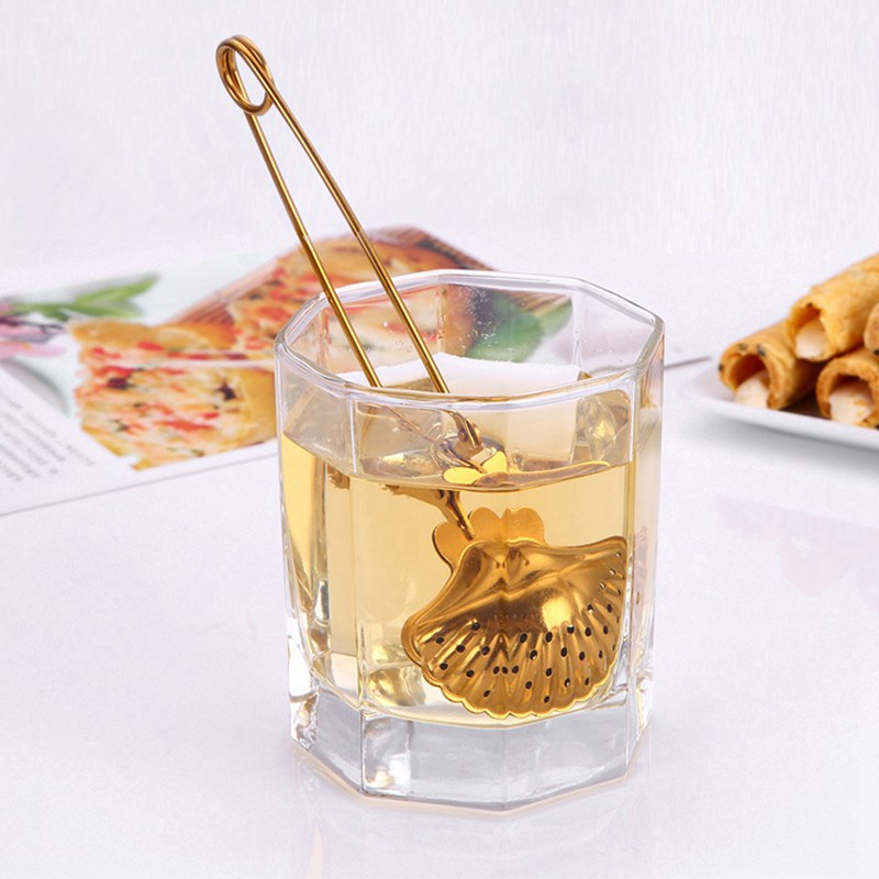 Купить с кэшбэком opening promotion-creative shell shape vacuum titanium plated stainless steel telescopic tea ball tea filter seasoning ball fi