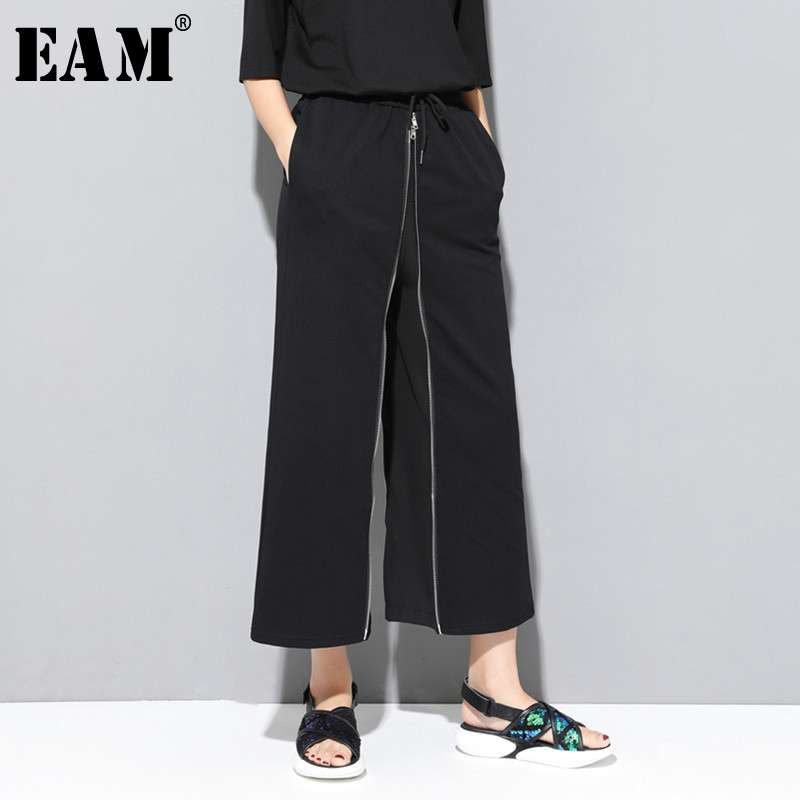[EAM] 2019 New Autumn Winter High Elastic Waist Black Zipper Split Joint Personality Loose Pants Women Trousers Fashion JS994