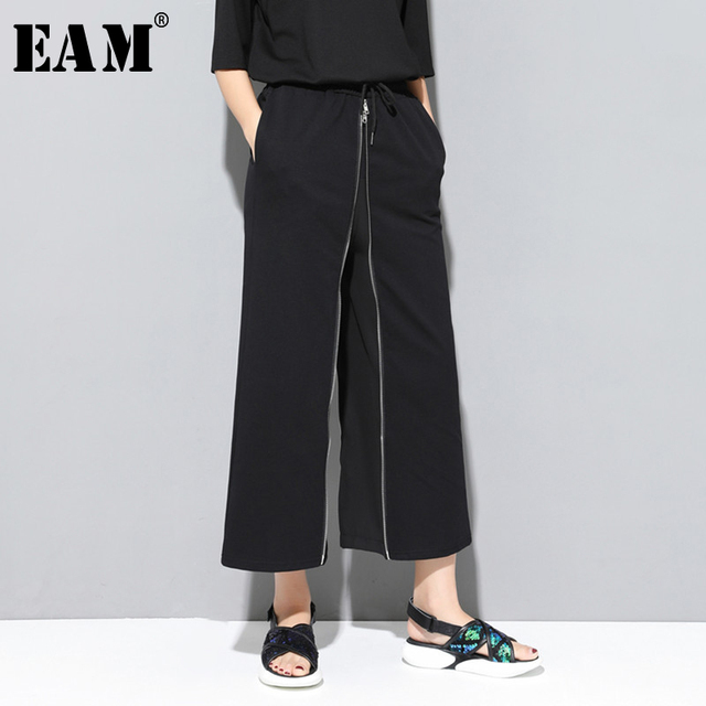 [EAM] 2020 New Spring Autumn High Elastic Waist Black Zipper Split Joint Personality Loose Pants Women Trousers Fashion JS994