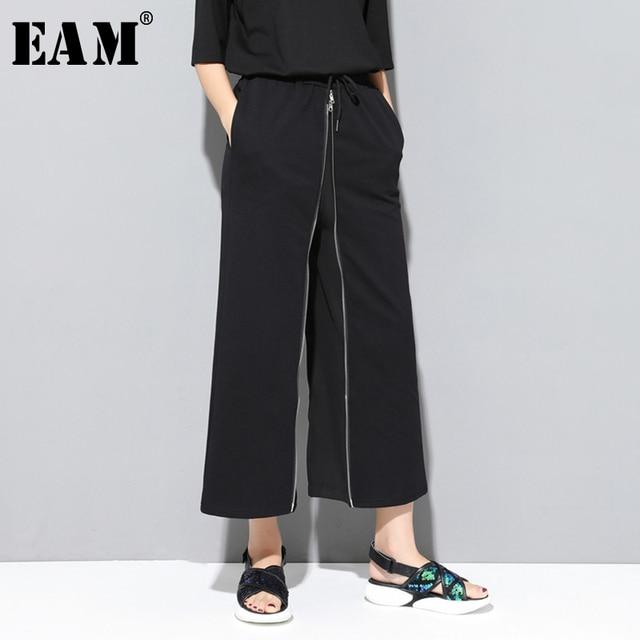 [EAM] 2020 חדש אביב סתיו גבוהה אלסטי מותניים שחור רוכסן פיצול משותף אישיות Loose מכנסיים נשים מכנסיים אופנה JS994