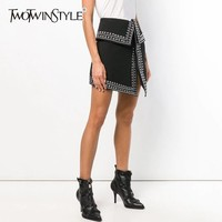 TWOTWINSTYLE Heavy Rivets Patchwork Skirt Female High Waist Sexy Asymmetrical Skirts For Women 2019 Spring Casual Fashion Tide