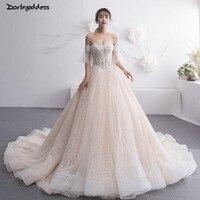 Luxury Beaded Wedding Dress 2019 Off Shoulder Short Sleeves Lace High end Wedding Dress with Long Train Vestido De Noiva