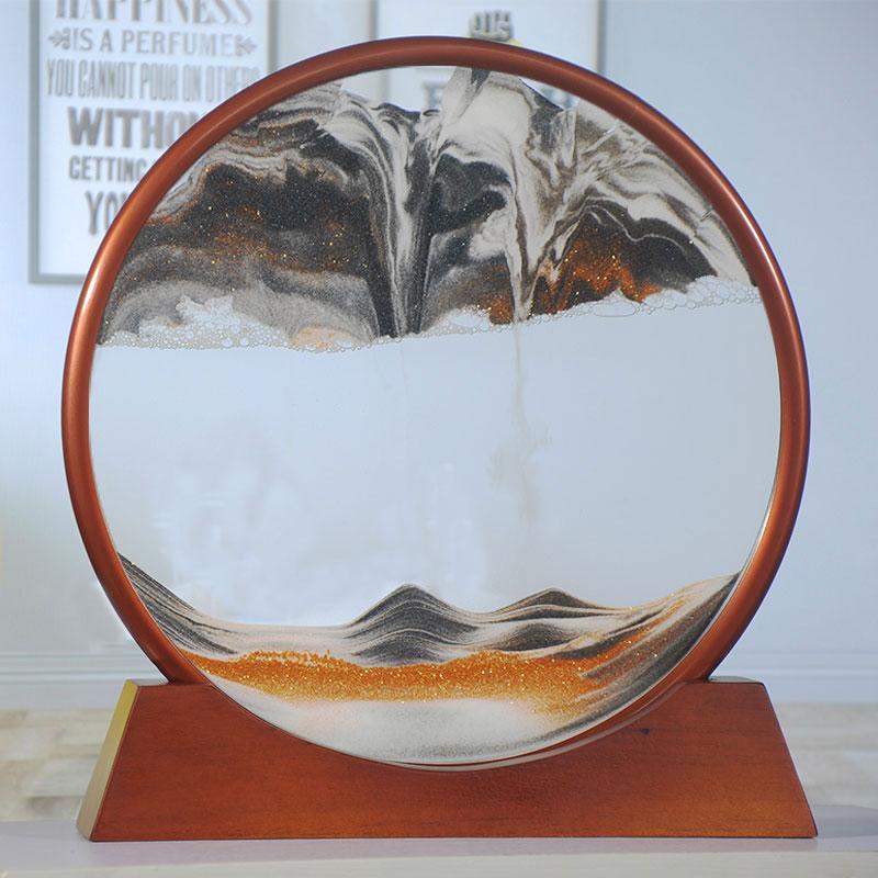 אמנות חול בתוך חישוק מתכתי בצבע ארד עם חול נשפך בתוכו