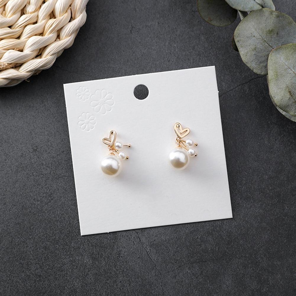 2019 Korean Fashion Women Earing Hollow Sweet Mini Love Heart Faux Pearl Ear Studs Earrings Lady Wedding Party Statement Jewelry in Stud Earrings from Jewelry Accessories