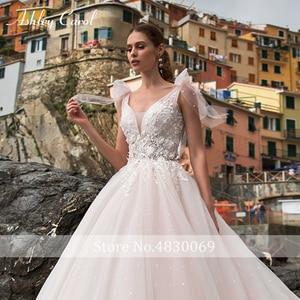 Image 4 - Ashley Carol A Line Wedding Dress 2020 Romantic Pearls Tulle Princess Bride Backless V Neck Appliques Beach Boho Bridal Gown
