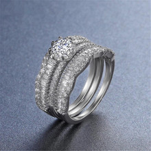 Huitan Luxury 3PC Wedding Ring Set with Round Brilliant Cubic Zirconia Prong Setting Fashion Jewelry Engagement Rings for Women