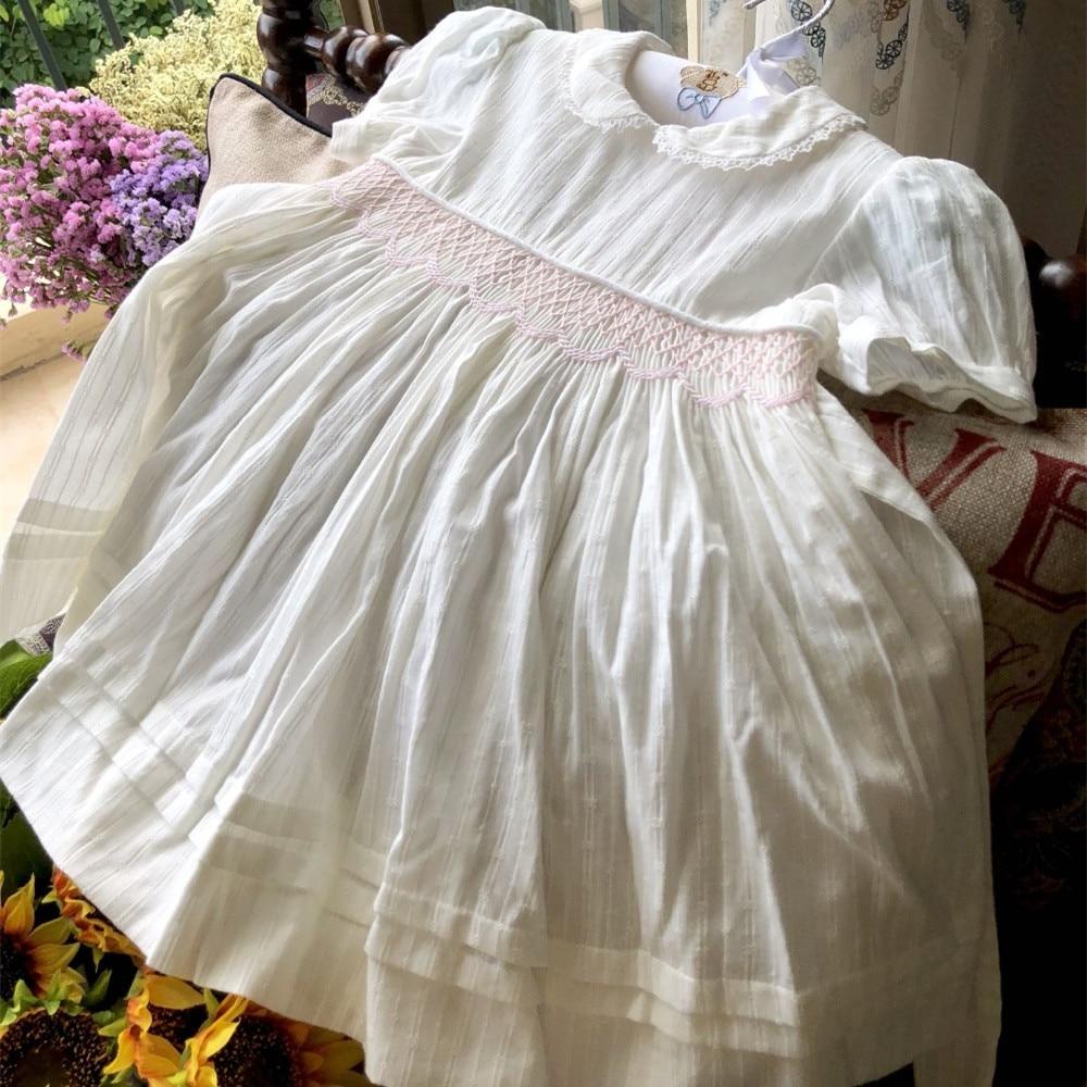 82fa0e926 Niños vestidos para niñas vestido de algodón blanco de smocking bebé niña  Ropa para Niñas ...