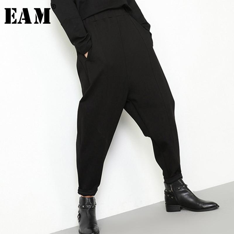 [EAM] 2019 New Autumn Winter High Elastic Waist Black Loose Pocket Long Brief Harem Pants Women Trousers Fashion Tide JK902