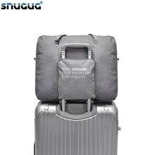 acd8a5ac2c SNUGUG Large Capacity Waterproof Folding Travel Bags Men Women Luggage  Duffel Duffle Bag Carry on Hand