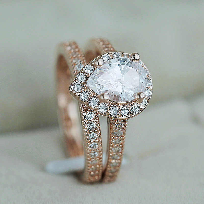 Huitan CLASSIC Solitaire แหวนน้ำหยด 2PC แหวน Micro Paved Elegant แหวนเจ้าสาวงานแต่งงานแหวนสำหรับผู้หญิง