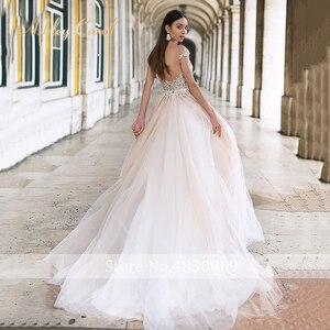 Image 4 - Ashley Carol Backless Appliques A Line Wedding Dress 2020 Beaded V neckline Sleeveless Chapel Train Bridal Gown Vestido de Novia