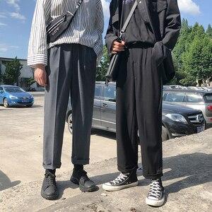 Image 1 - موضة الربيع 2019 النسخة اليابانية من سراويل الرياح المدرسية للرجال فضفاضة غير رسمية بلون بسيط Sweatpants