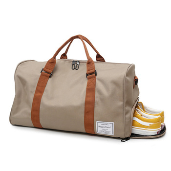 9425c2066 Las mujeres de la marca lona bolsas de viaje 2019 bolsos de las señoras de  gran capacidad de lona impermeable equipaje de mano de viaje bolsa de lona