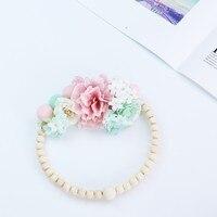 Cercle déco fleur perle bois 3