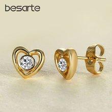 Женские серьги гвоздики в форме сердца золотистые с кристаллами