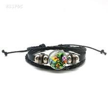 Кожаный браслет с тропическим попугаем и цветными цветами черный