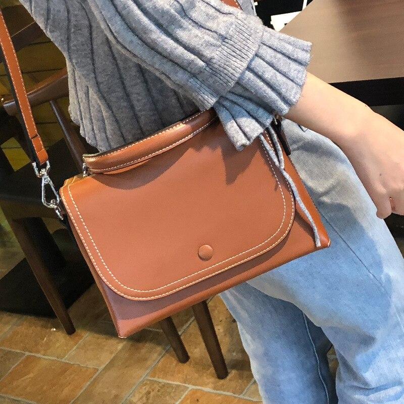 Haute qualité en cuir véritable femmes fronde Messenger sac fourre-tout sac à main mode nouveau Simple véritable peau de vache croix corps sacs à bandoulière