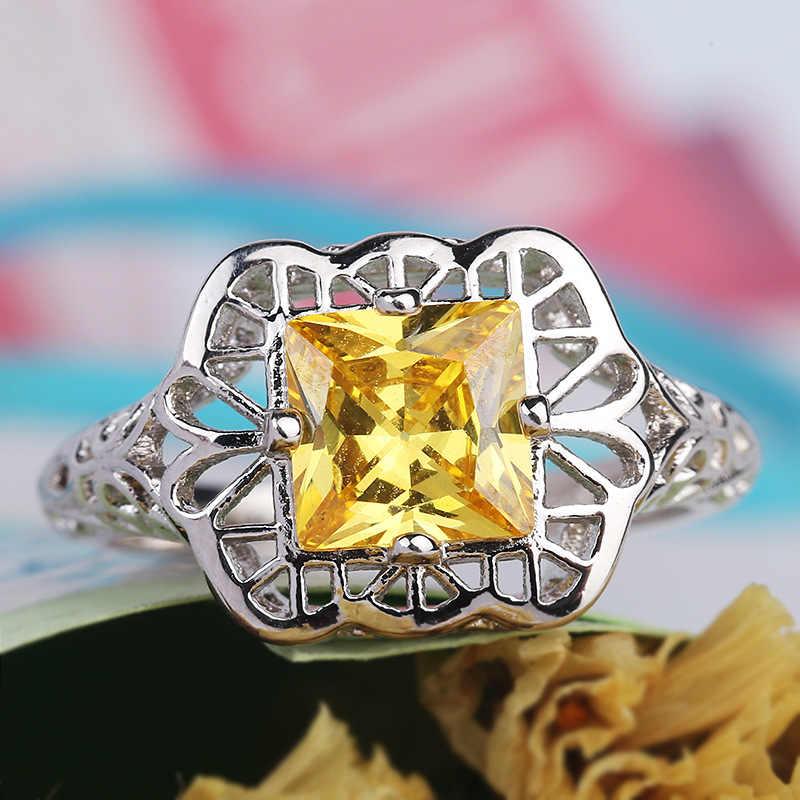 Anillos de boda de circonita amarilla AAA para mujeres hueco de moda Corazón y flecha anillo taladro 925 Plata tendencias europeas y americanas
