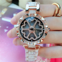2019 New Designs Rotating Quartz Watch Waterproof Fashion Hollow Flower Zircon Steel Strap Watch for Women Jewelry
