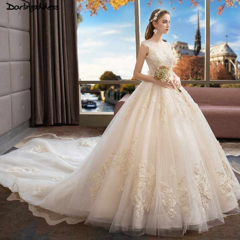 2052266192c Luxury Gold Lace Wedding Dress Dubai Champagne Ball Gown Wedding Dresses  2019 Backless Cap Sleeve Vintage