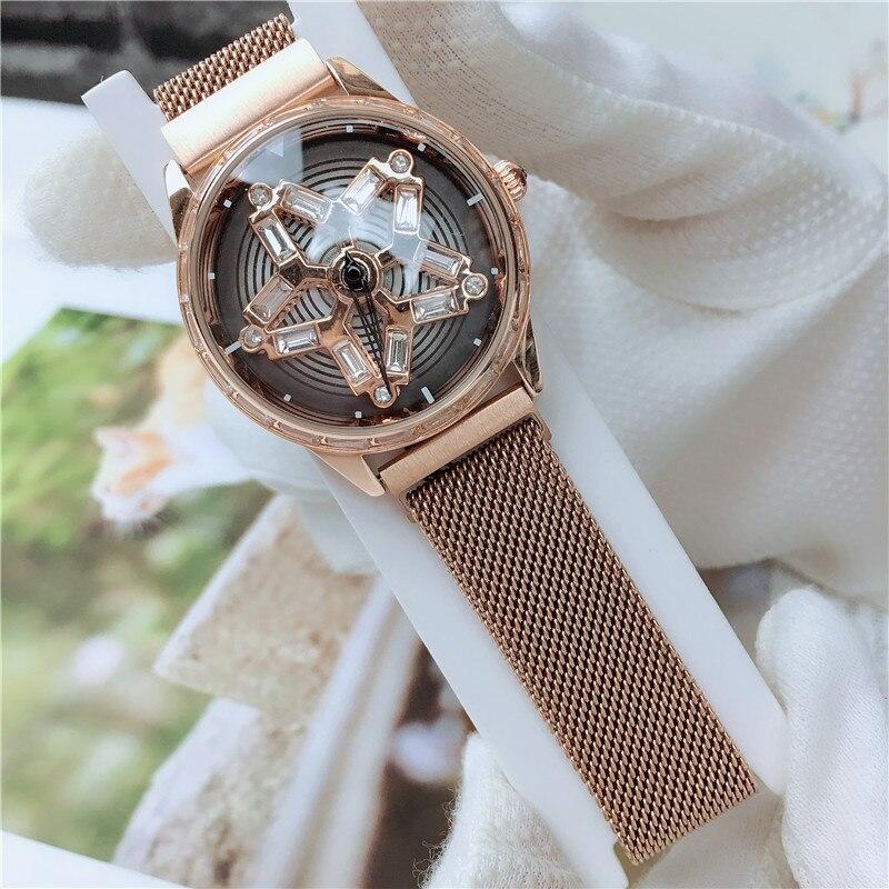Chic montres à Quartz étanche mode créatif rotatif diamant fleur cadran aimant sangle horloge poignet pour les femmes