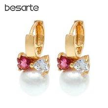 Женские серьги кольца с кристаллами золотыми сердечками и жемчугом