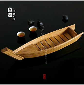 Japanese sushi bamboo boat artistic conception salmon lobster dry ice long cooking boat dish seafood and radish raw fish plate