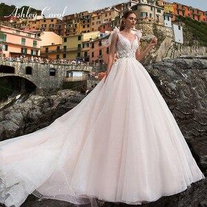 Image 1 - Ashley Carol A Line Wedding Dress 2020 Romantic Pearls Tulle Princess Bride Backless V Neck Appliques Beach Boho Bridal Gown