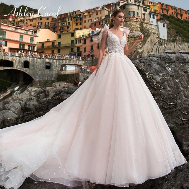 Ashley Carol A Line Wedding Dress 2020 Romantic Pearls Tulle Princess Bride Backless V Neck Appliques Beach Boho Bridal Gown