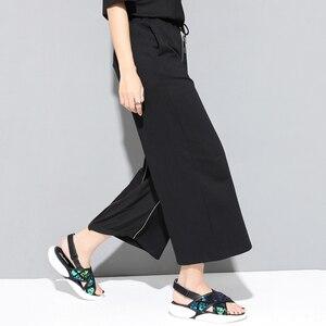 Image 5 - [EAM] 2020 חדש אביב סתיו גבוהה אלסטי מותניים שחור רוכסן פיצול משותף אישיות Loose מכנסיים נשים מכנסיים אופנה JS994