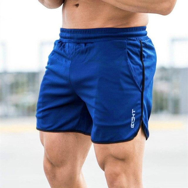 4935b05e5215 € 4.79 45% de DESCUENTO Los nuevos hombres Fitness culturismo pantalones  cortos verano hombre gimnasios entrenamiento hombre de malla transpirable  ...