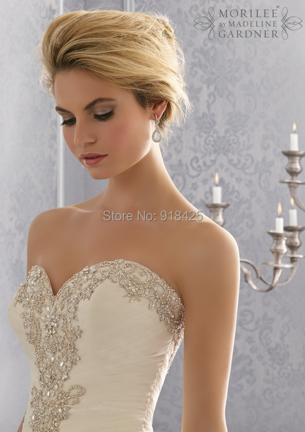 Вышивки бисером на свадебных платьях