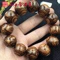 2 cm El Mar Amarillo Hainan aguacate pera Perlas Pulsera 20mm hombres de la cara llena ojos araña patrón boutique