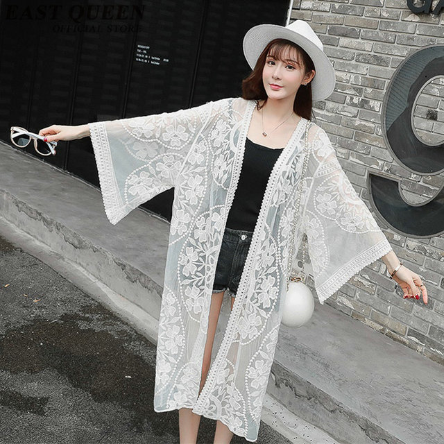 8a7621251c7a5 US $24.75 45% OFF|woman's fashion 2018 summer long cardigan casual beach  cardigan femme flare sleeve white lace cardigan free size NN0679 YQ-in ...