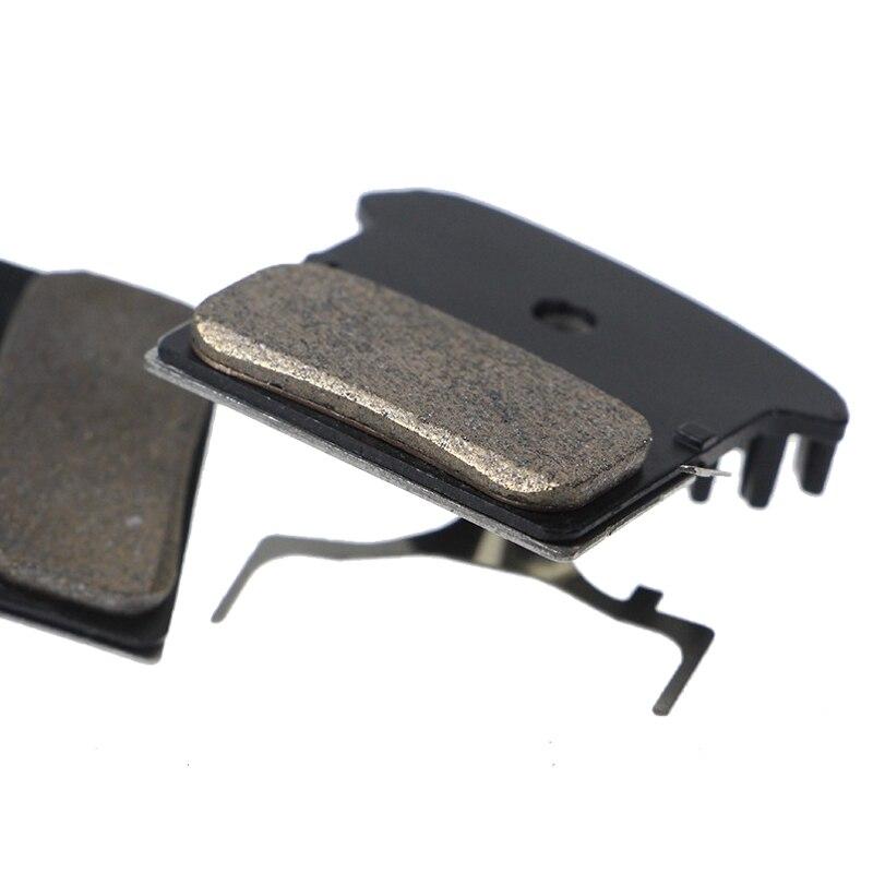 Купить с кэшбэком For SHIMANO J02a J03a Pads DEORE XT SLX DEORE J02a J04C Cooling Fin Ice Tech Mountain M785 M675 M7000 M8000 Bicycle Brake Pad
