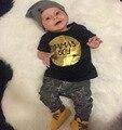 2017 nuevo estilo bebé ropa de la muchacha Carta negro corto ropa de la camiseta + pantalones recién nacido caca del bebé que arropan el sistema bebe