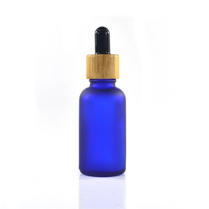 Image 2 - 100pcs 30ml essential oil glass bottle 1oz glass dropper bottle with bamboo cap glass essential oil bottle cosmetic packaging