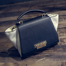 2016 new fall fashion handbags/panelled color wings trend handbag/shoulder lock trapeze women messenger bag/black PU leather bag